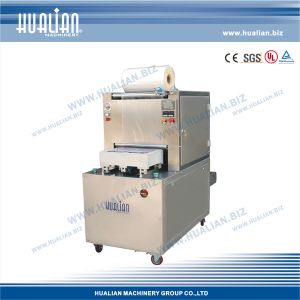 Hualian 2015 Tray Vacuum Packaging Machinery (HVT-450M/2) pictures & photos