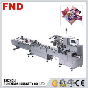Automatic Flow Packaging Machine for Chocolate/Biscuit/Waffer (FND-F550A) pictures & photos