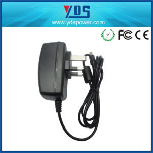 12V 2A UK Wall Plug in Adapter pictures & photos