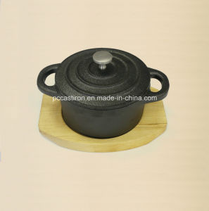 Preseasoned Cast Iron Mini Serving Skillet with Wooden Base Oil Finished pictures & photos