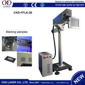 Qr Code 20W Flying Laser Printing Machine for Fabric pictures & photos