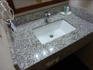 dessus blanc de vanit de salle de bains de partie sup rieure du comptoir de cuisine de granit. Black Bedroom Furniture Sets. Home Design Ideas