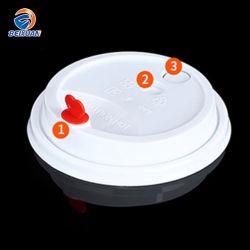 ミルクの茶使い捨て可能なコップのふたのための卸し売り普及した白いプラスチック帽子