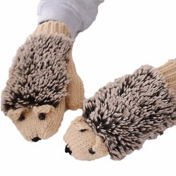 かわいいパターンは漫画のスマートで暖かい冬のウールによって編まれる手袋をからかう