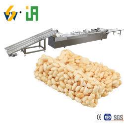 生産ラインの中のナットが付いている自動穀物棒棒キャンディの穀物棒機械忍び笑い棒
