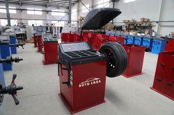 Manutenção de automóveis em movimento do pneu e a máquina de equilibragem