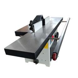 Come usare un modellatore dell'asse di rotazione, anche conosciuto come uno shaper. di legno