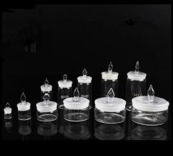 Forme basse en verre clair de la bouteille de pesage avec couvercle