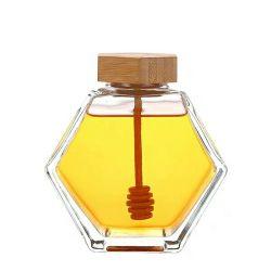 L'emballage vide CERTIFIÉES ISO EN VERRE Pot de miel avec couvercle en bois