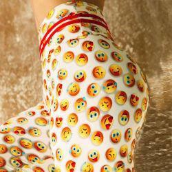 微笑の表面印刷のエアロビクスによっては高いウエストおよび美しいバトックの練習の堅いズボンのヒップの持ち上がる適性のズボンが喘ぐ