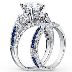 ダイヤモンドの青のサファイアが付いている14k白い金の婚約指輪