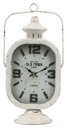 ساعة طاولة على الطراز الأمريكى ومكواة ساعة قديمة