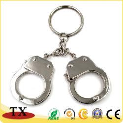 승진 품목을%s 열쇠 고리가 금속 경찰에 의하여 수갑을 채운다