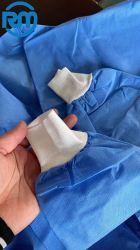 격리 가운 처분할 수 있는 가운 PE 탄력 있는 처분할 수 있는 보호의, PP 의학 격리 가운 - 및 뜨개질을 한 팔목을%s 가진 방어적인 가운 비 길쌈된 직물