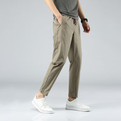Pantaloni classici diritti del Harem del denim del cotone degli uomini dei pantaloni