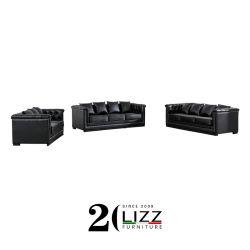 Un mobilier moderne salle de séjour avec canapé en cuir Chesterfield de cuivre ou de clous d'argent