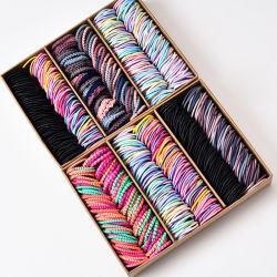 Bandas elásticas de nylon de cabello a los niños una banda de caucho tipo diadema