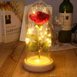 وردة الحرير الأحمر وضوء LED الذي يدوم حتى الآن