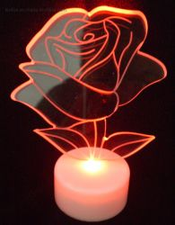 أشعلت فوق لوح [لد] أكريليكيّ [روس] عيد ميلاد المسيح زخرفة بهيجة