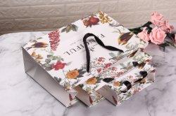 Sacchetto di acquisto fatto a mano del regalo della carta patinata di alta qualità cosmetica per l'imballaggio e la promozione