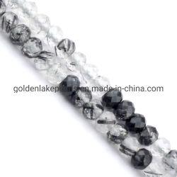 宝石用原石は黒いRutilated水晶によって彫面を切り出されるRondelles 2X3mmに玉を付ける