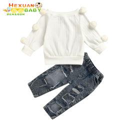 2020の新しい子供の女の赤ちゃんセットの落下冬の衣服2PCSの毛皮のポンポンの袖のセーターの穴はデニムのズボンの女の子衣服によってセットされた1-5yを裂いた