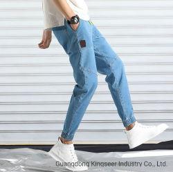 Il modo all'ingrosso degli uomini personalizzato Jean del contrassegno privato della fabbrica ansima i jeans inferiori stretti del denim dei vestiti del tessuto dei vestiti dell'indumento dell'abito dell'OEM dei pantaloni