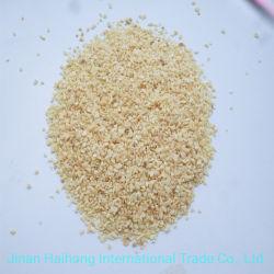 Los gránulos secos picados de tierra vegetal picada de ajo granulado