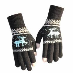 Gli uomini e le donne dello schermo di tocco dei cervi del fiocco della neve di natale scaldano i guanti