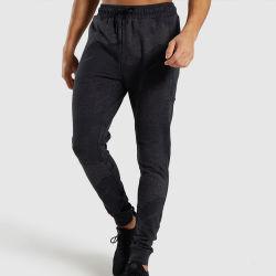 La llegada de nuevos pantalones de cintura alta Deportes Wicking sudor Mens Slim Fit vía pantalones