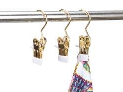 Abraçadeira pequena de um gancho de metal dourado de hangar para lenços de Hat Boot