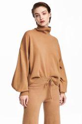 La mujer de cuello de tortuga extra moda informal suéter de lana con pantalones
