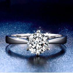 18K丸型の白い宝石用原石の約束DカラーMoissaniteのダイヤモンドの宝石類のリング