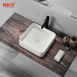 人工的な石造りのアクリル樹脂のCorianの固体表面のキャビネットの壁のこつのカスタム大理石の軸受けのテーブルの上の正方形の円形の白く黒い虚栄心の浴室の流しの洗面器
