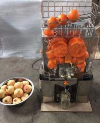 Jus d'orange frais pressé la machine et agrumes centrifugeuse électrique