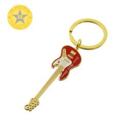 Le couteau scie à chaîne de clés plaqué laiton antique avec le charme de métal