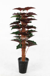 La decoración del hogar de las plantas de hoja de taro artificial con fondo rojo