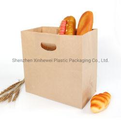 型抜きされたハンドルのファースト・フードのパンを持つリサイクルされたブラウンクラフトはショッピング包装袋を取り除く