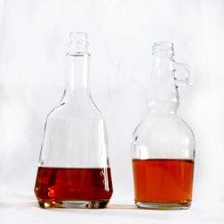 حاوية زجاجية مع مقبض، زجاجة زجاجية مع جسم شفاف، زجاجة زجاج مسطحة ذات قاعدة مسطحة عالية الجودة وقناني زجاج شفاف/وردي بوردو