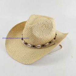 シェルが付いている手すき紙のわらは西部の帽子に玉を付ける