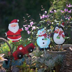 Il natale picchetta la decorazione dell'iarda dell'automobile del pupazzo di neve e della Santa del metallo per le decorazioni esterne del giardino