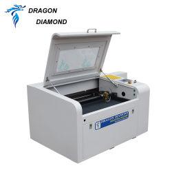 Ausschnitt-Maschine CO2 Laser-Stich-eingetragenes Warenzeichen, das für hölzernes acrylsauerleder schnitzt