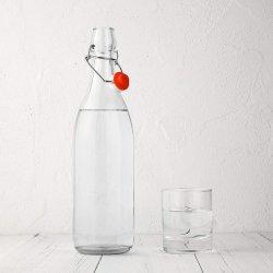 1LTRは飲料およびジュースの水差しのためのストッパーガラス飲むびんが付いているガラスビンを取り除く