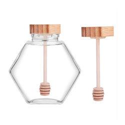 卸し売り工場価格SGSは敏感な出現の木のふたが付いているガラス蜂蜜の瓶をかディッパーまたはステッカー証明した