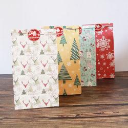 クリスマスのペーパー袋の食糧金庫はゲストのための誕生日の結婚披露宴の好意キャンデーのパッキングを袋に入れる