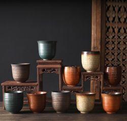 Il Giappone variopinto designa una tazza di tè di ceramica del caffè dell'intero insieme e gli insiemi di tè di ceramica impostati tazze foggiano a coppa un POT del tè con quattro tazze