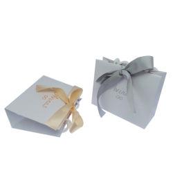Les ventes à chaud logo personnalisé sac cadeau avec le ruban de papier pour mariage