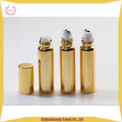 Rullo della pittura galvanizzato oro sulla bottiglia di olio essenziale