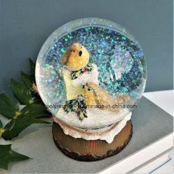 I mestieri della palla di neve del globo della neve con le parole imprimono sulla sfera di vetro