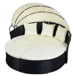 黒い屋外の円形のテラスの藤のソファーの家具